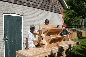 Student carpenters with cart at stable side door(001)(001)